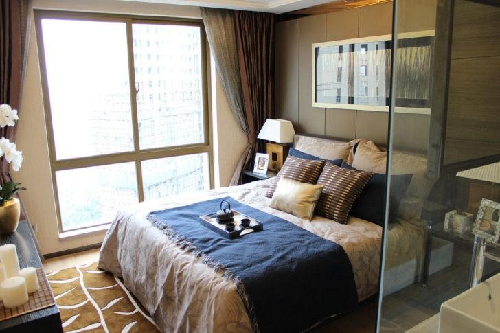 Dormitorio elegante en tonos nuetros