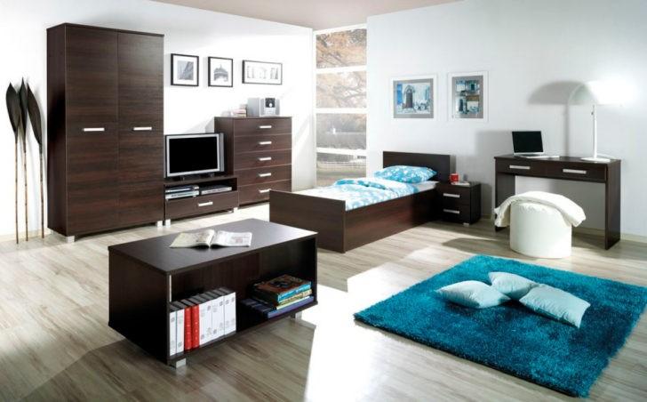 Dormitorio adolecente con muebles oscuros